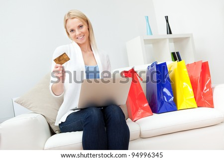 Beautiful woman shopping online - stock photo