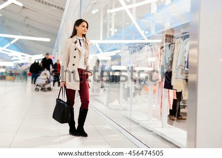 Beautiful woman shopping trendy clothes - stock photo