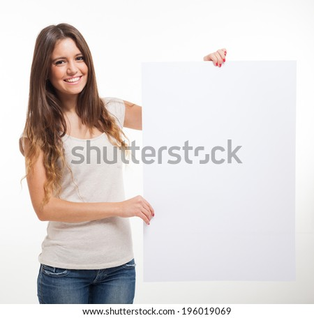 Beautiful woman showing a blank sign - stock photo