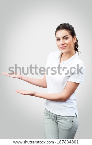 Beautiful  woman showing blank area for sign or copyspace, isolated over white background - stock photo
