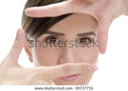 beautiful woman showing framing hand gesture on an isolated white background - stock photo
