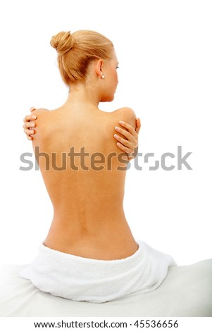 Beautiful woman showing her back isolated on white - stock photo