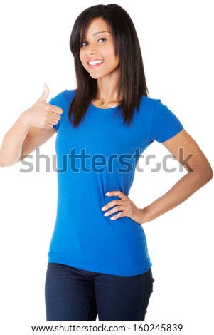 Beautiful woman showing her thumb up in a smile. Isolated on white background.  - stock photo