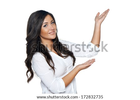 Beautiful  woman showing / holding on the palm blank copy space over white background - stock photo