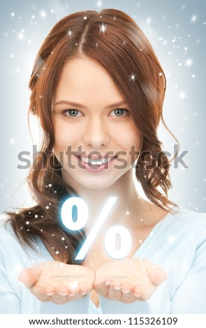 beautiful woman showing percent sign on the palms of her hands - stock photo