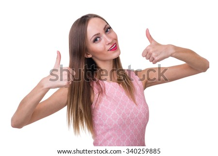 Beautiful woman showing thumbs up, isolated over a white background - stock photo