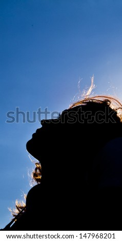 beautiful woman silhouette with star heart Copy space for inscription - stock photo