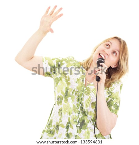 Beautiful woman singing and dancing - stock photo