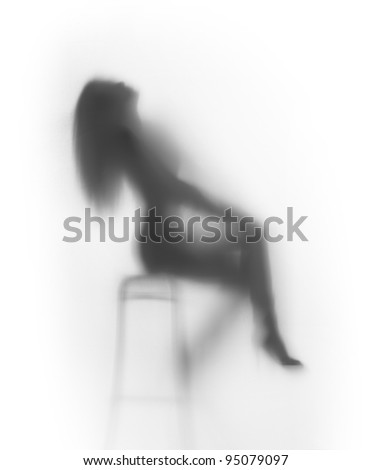 Beautiful woman sits on chair, silhouette