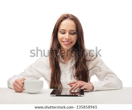 beautiful woman sitting at the table with tablet and cup - stock photo