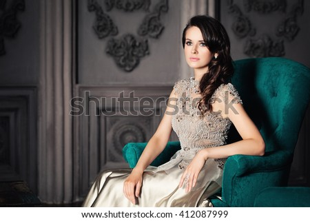 Beautiful Woman Sitting in a Armchair - stock photo