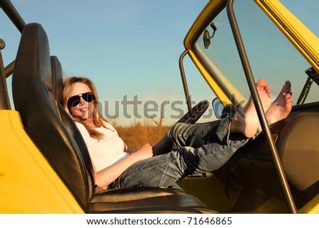 Beautiful woman sitting in a car - stock photo