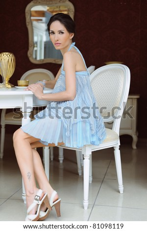 beautiful woman sitting in a chair in the house