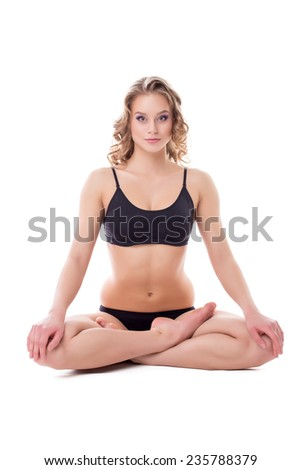 Beautiful woman sitting in lotus position