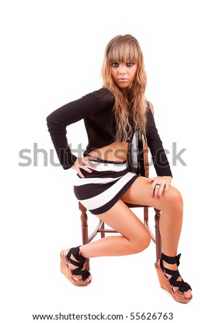 Beautiful woman sitting on a chair - isolated