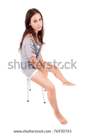 Beautiful woman sitting on a chair, isolated
