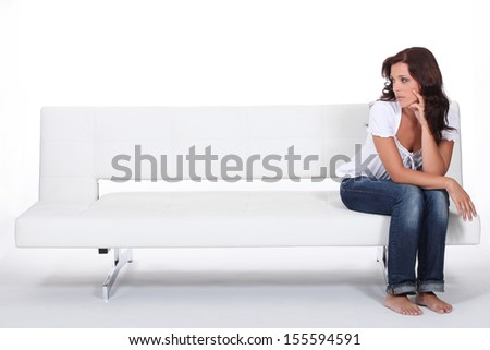 beautiful woman sitting on a couch