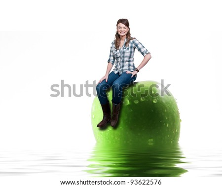 Beautiful woman sitting on a wet apple sitting in water - stock photo
