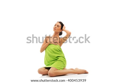Beautiful woman sitting wrapped in towel