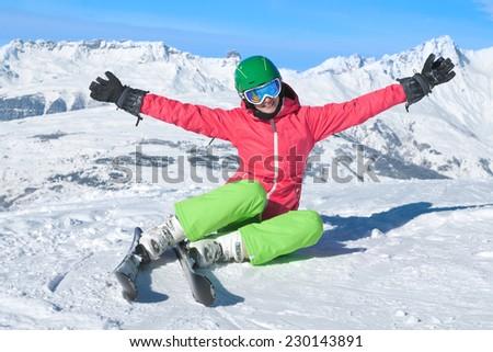 Beautiful woman skiing in the Alps - stock photo