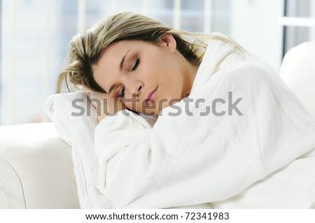 Beautiful woman sleep on the white background - stock photo