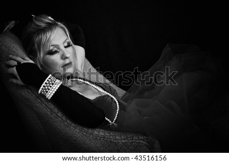 beautiful woman sleeping in black and white with her arms up. - stock photo