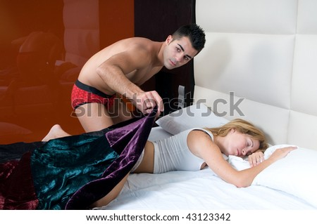 beautiful woman sleeping on bed and silence man