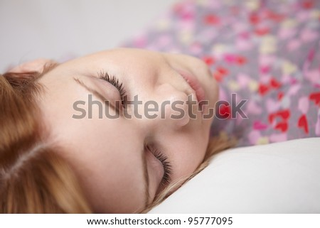 Beautiful woman sleeping on sofa - stock photo
