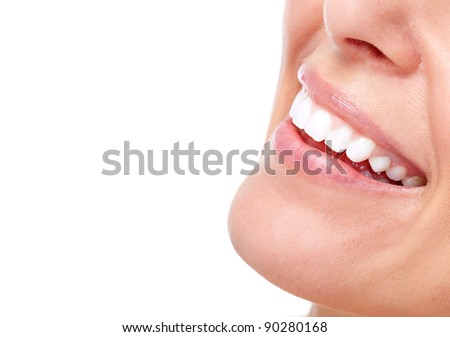 Beautiful woman smile and teeth. Isolated over white background. - stock photo