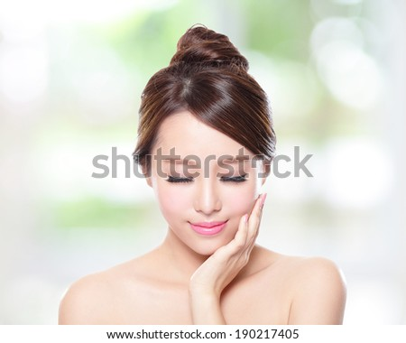 Beautiful woman smile face with clean face skin, and closed eyes , concept for eye and skin care,nature green background, asian - stock photo