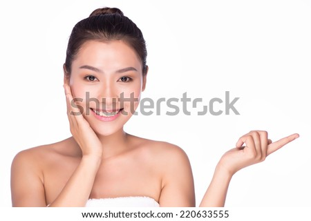 Beautiful woman smile face with clean face skin, and finger touch her eyes , concept for eye and skin care, over nature green background, asian beauty - stock photo