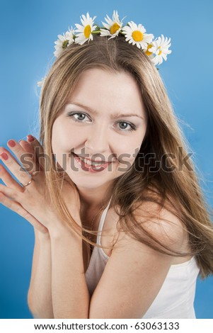 Beautiful woman smiles on a blue background - stock photo