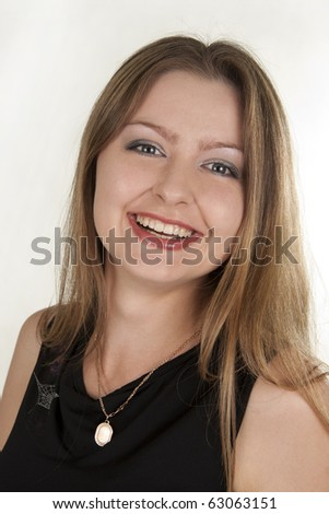 Beautiful woman smiles on a white background - stock photo