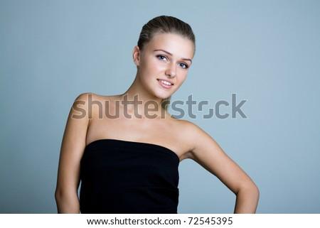 Beautiful woman smiles. Studio shot - stock photo