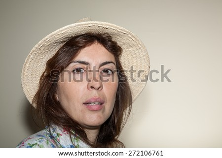 Beautiful woman smiling - close up.Gray background.