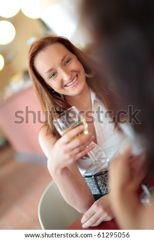 Beautiful woman smiling in a restaurant - stock photo