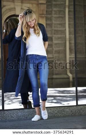 Beautiful woman smiling in town - stock photo