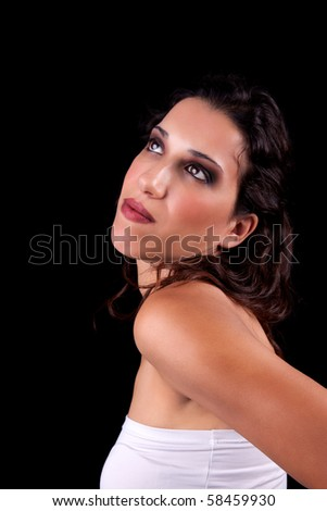 Beautiful Woman Smiling looking up, isolated on black background. Studio shot. - stock photo