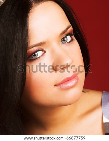 Beautiful  woman  smiling over a red background