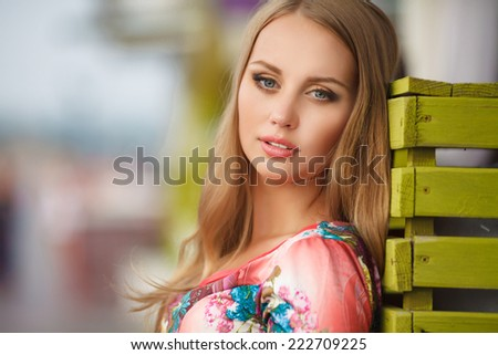 Beautiful woman smiling portrait, happy young girl outdoors. Joyful woman face. woman walking city street. series. - stock photo