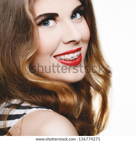 Beautiful woman smiling with braces - stock photo