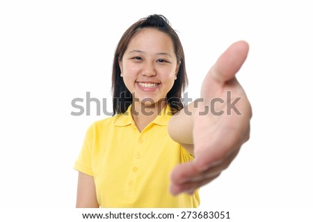 Beautiful woman smiling with welcome gesture - stock photo