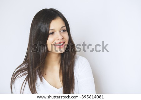 Beautiful woman smiling.  Young Female touching Her Skin. Portrait  on White Background.  Perfect Skin. Beauty Face.