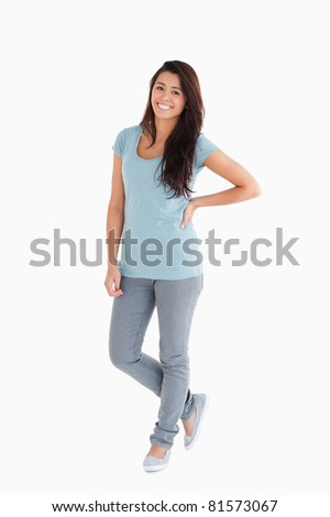 Beautiful woman standing against a white background - stock photo