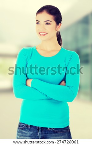 Beautiful woman standing and looking leftp into copy space - stock photo