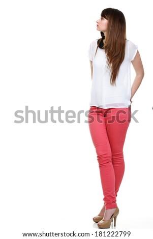Beautiful woman standing and looking up Studio shot. - stock photo