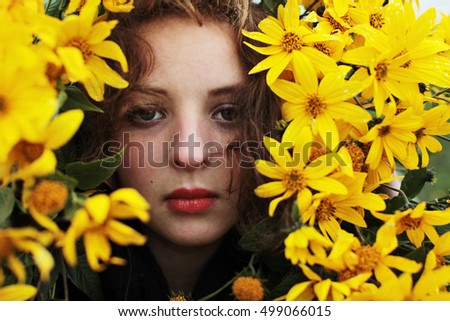 Beautiful woman standing in rapeseed field