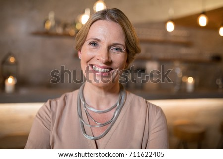 Beautiful woman standing in restaurant