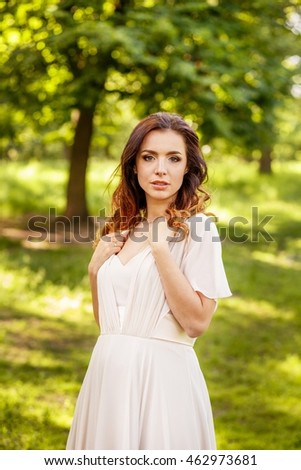 Beautiful woman standing in the park
