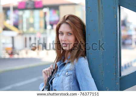 Beautiful woman standing in town